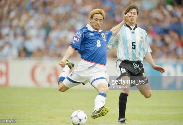 Hidetoshi Nakata of Japan shapes to shoot during the World Cup group H game against Argentina at the Stade Municipal in Toulouse France Argentina won...