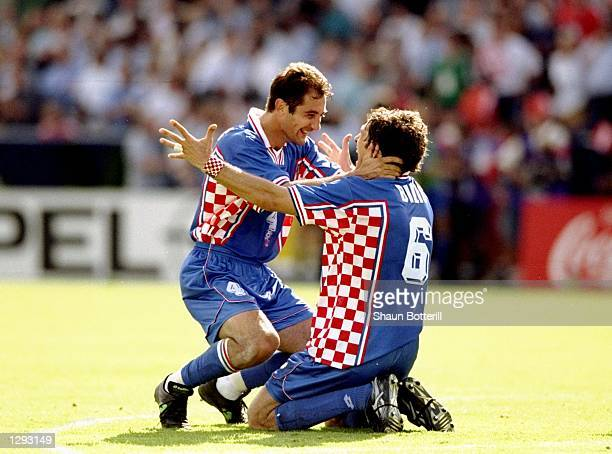 Igor Stimac of Croatia celebrates with team mate Slaven Bilic after the World Cup second round match against Romania at the Parc Lescure in Bordeaux...