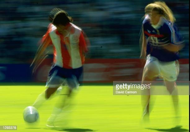Impression of Jose Cardozo of Paraguay taking on Emmanuel Petit of France during the World Cup second round match at the Stade Felix Bollaert in Lens...