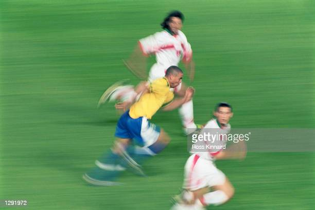 Impression of Ronaldo of Brazil terrorising the Morocco defence during the World Cup group A game at the Stade de la Beaujoire in Nantes France...