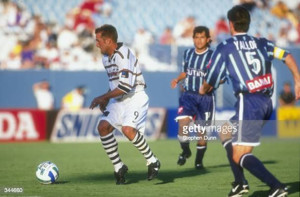 Jason Kreis of the Dallas Burn is pursued by Frank Yallop of the Tampa Bay Mutiny during a game at the Cotton Bowl in Dallas, Texas. The Mutiny...