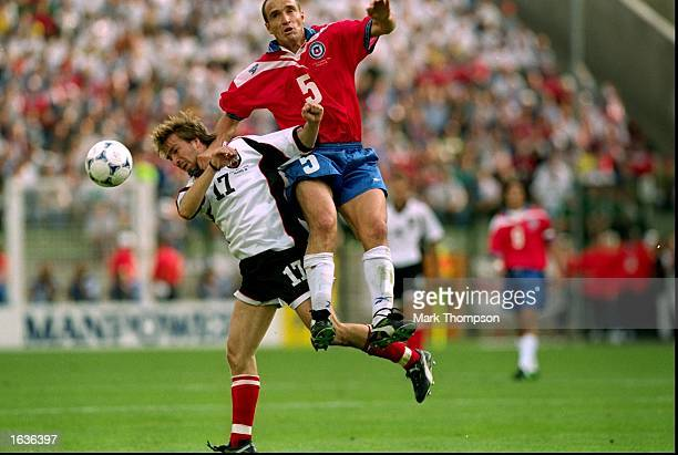 Javier Margas of Chile climbs above Roman Mahlich of Austria during the World Cup group B game at the Geoffroy Guichard Stadium in St Etienne France...