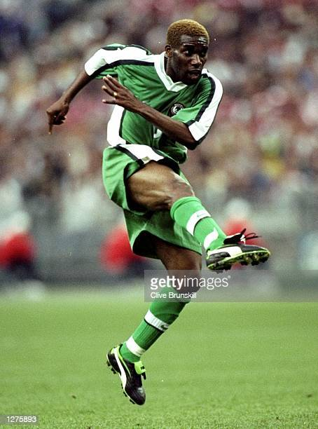 Jay Jay Austine Okocha of Nigeria in action during the World Cup second round match against Denmark at the Stade de France in St Denis, France....
