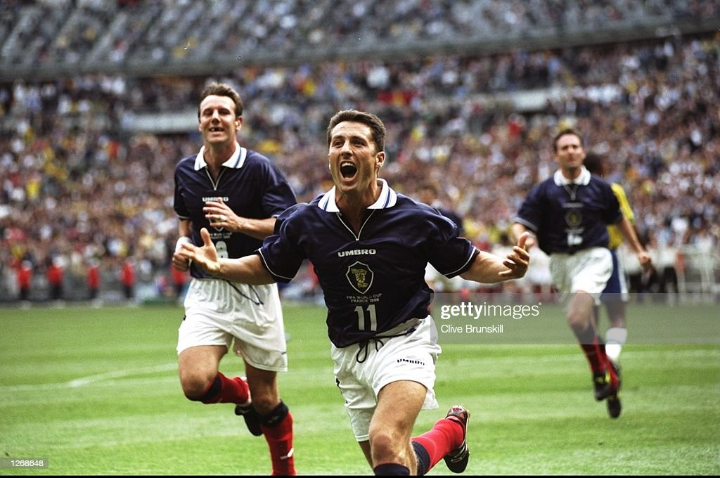 John Collins of Scotland celebrates after scoring from the penalty spot during the World Cup group A game against Brazil at the Stade de France in St Denis, France. Scotland went on to lose 2-1. \ Mandatory Credit: Clive Brunskill /Allsport