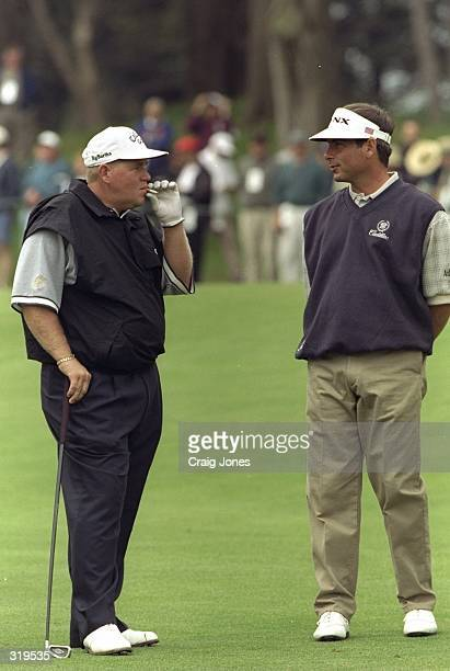 John Daly and Fred Couples talk during the 1998 US Open Championships on the 6797yard par70 Lake Course at The Olympic Club in San Francisco...