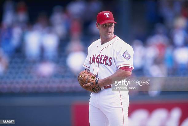 John Wetteland of the Texas Rangers in action during a game against the Oakland Athletics at The Ballpark in Arlington Texas The Rangers defeated the...