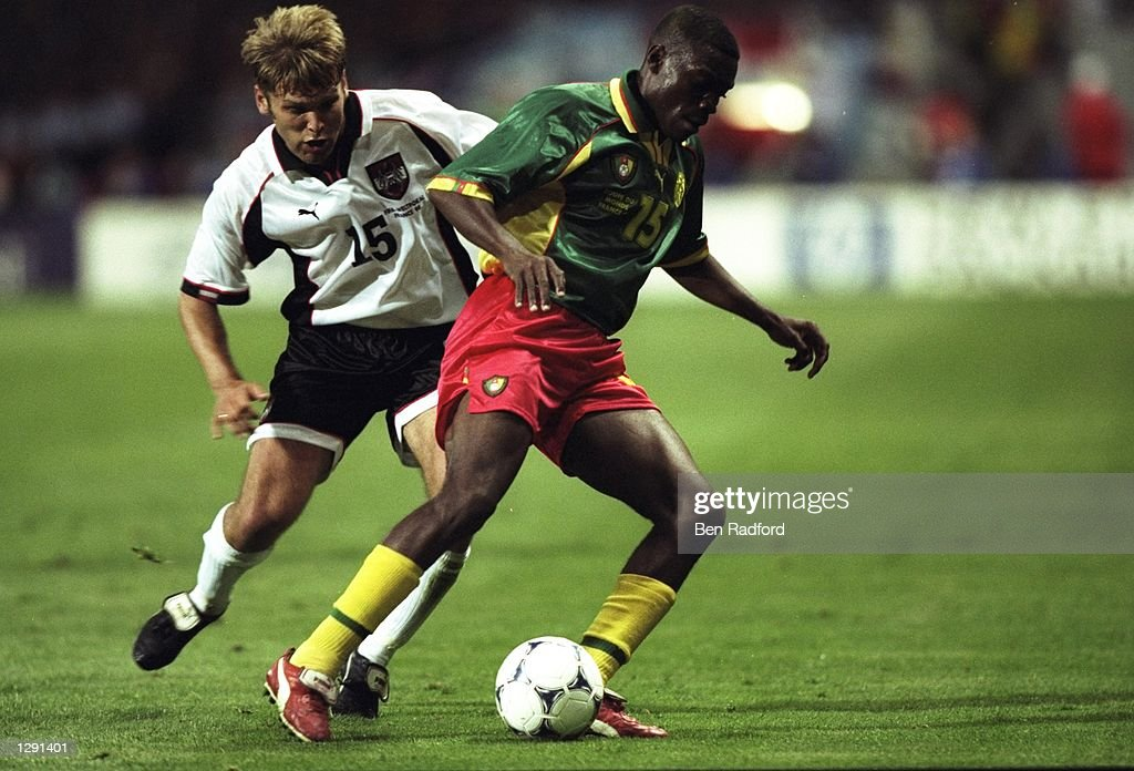 Joseph Ndo of Cameroon is closed down by Arnold Wetl of Austria during the World Cup group B game at the Stade Municipal in Toulouse, France. The game ended 1-1. \ Mandatory Credit: Ben Radford /Allsport