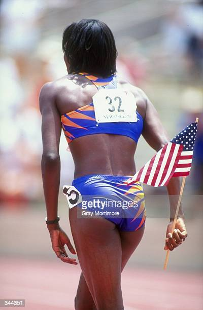 Kim Batten carries the American flag with her after winning the Women''s 400m Hurdles during the US Track Field Championships at the Tad Gormley...