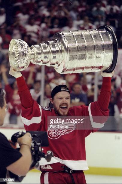 Kris Draper of the Detroit Red Wings holds up the Stanley Cup during the Stanley Cup Finals game against the Washington Capitals at the MCI Center in...