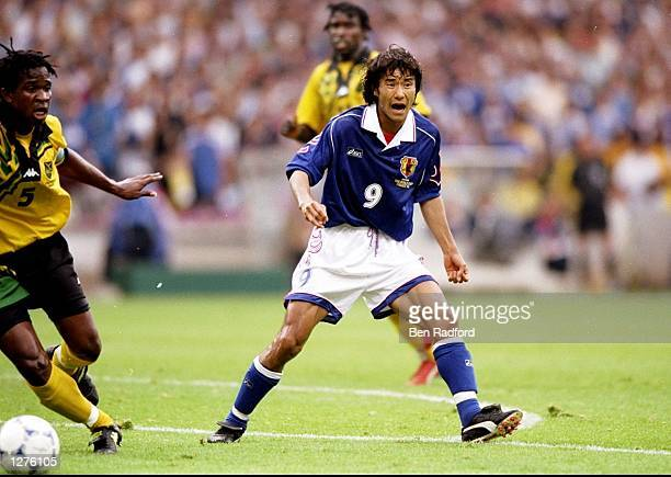 Masashi Nakayama of Japan plays a through ball during the World Cup first round match against Jamaica at the Stade Gerland in Lyon, France. Jamaica...