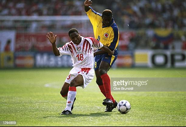 Mehdi Ben Slimane of Tunisia goes past Adolfo Valencia of Colombia during the World Cup group G game at the Stade de la Mosson in Montpellier France...