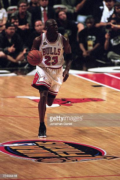 Michael Jordan of the Chicago Bulls dribbles the ball down the court during the NBA Final game against the Utah Jazz at the United Center in Chicago...