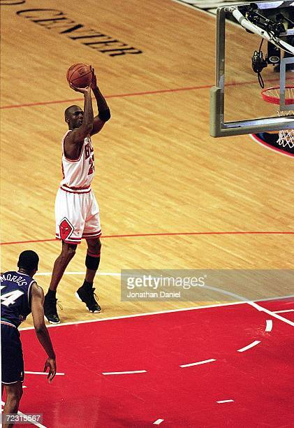 Michael Jordan of the Chicago Bulls shoots the ball during the NBA Finals game against the Utah Jazz at the United Center in Chicago Illinois The...