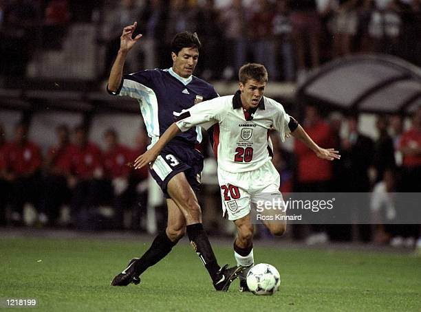 Michael Owen of England in action against Jose Chamet of Argentina during the 1998 World Cup match against Argentina played in St Etienne France The...