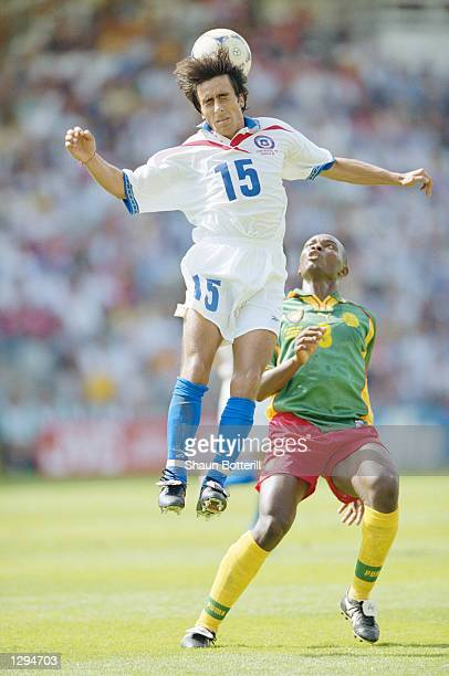 Moises Villarroel of Chile rises above Pierre Wome of Cameroon during the World Cup group B game at the Stade de la Beaujoire in Nantes France The...