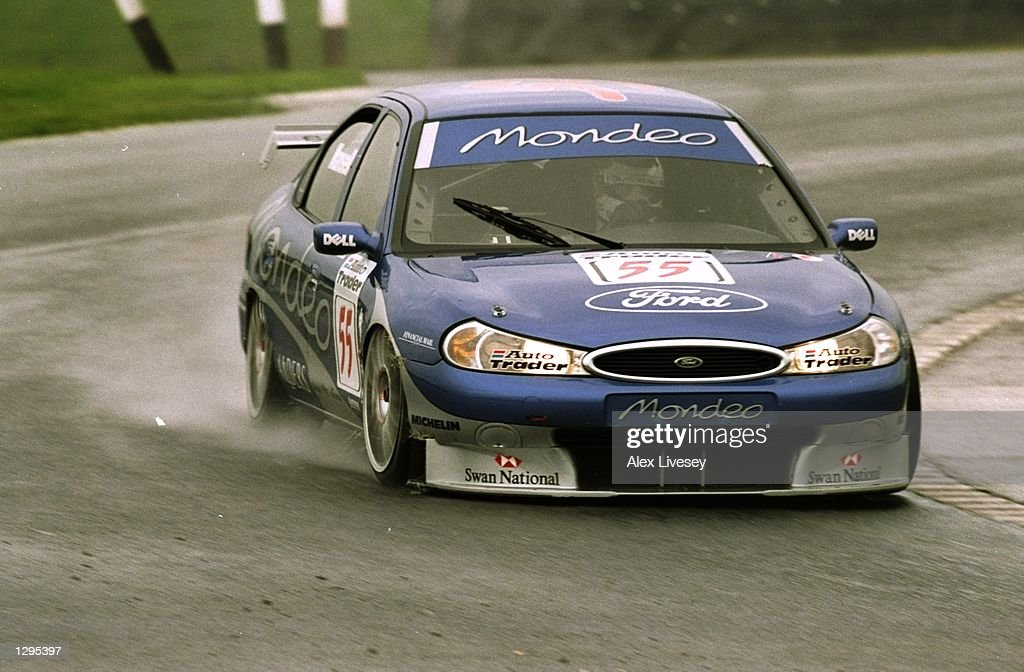 Nigel Mansell of Great Britain and the Ford Mondeo team in action : News Photo