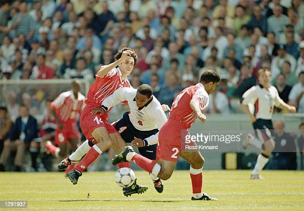 Paul Ince of England is brought down by Siraj Chihi of Tunisia during the World Cup group G game at the Stade Velodrome in Marseille France England...