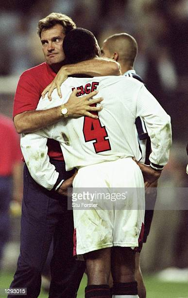 Paul Ince of England is consoled by coach Glenn Hoddle after seeing his penalty saved during the shootout in the World Cup second round match against...