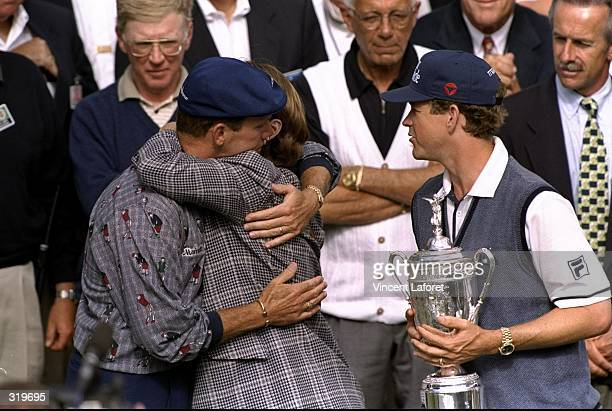 Payne Stewart of the USA hugs Beverly Janzen as Lee Janzen looks on during the 1998 US Open Championships on the 6797yard par70 Lake Course at The...