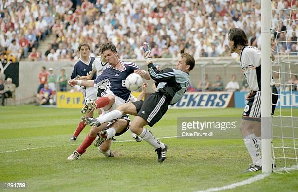 Predrag Mijatovic of Yugoslavia goes in on Andreas Kopke of Germany during the World Cup group F game at the Stade Felix Bollaert in Lens France...
