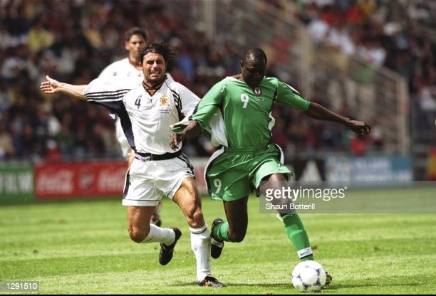 Rasheed Yekini of Nigeria goes past Rafael Alkorta of Spain during the World Cup group D game at the Stade de la Beaujoire in Nantes France Nigeria...