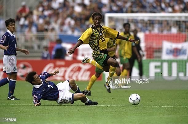 Ricardo Gardener of Jamaica skips past Akira Narahashi of Japan during the World Cup group H game at the Stade Gerland in Lyon, France. Jamaica won...