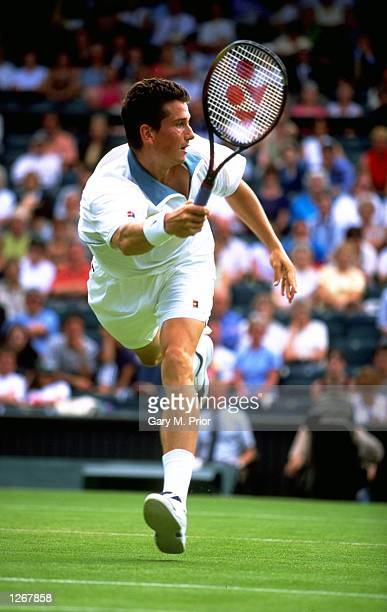 Richard Krajicek of Holland stretches for a volley in his match against Brett Steven of New Zealand during the 1998 Wimbledon Championships played at...