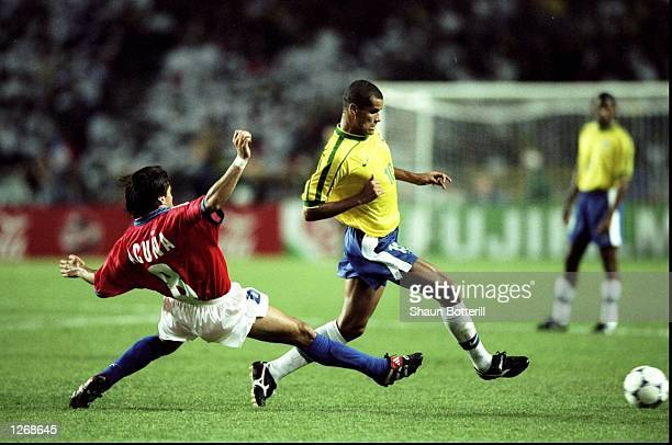 Rivaldo of Brazil goes past Clarence Acuna of Chile during the World Cup second round match at the Parc des Princes in Paris Brazil won 41 Mandatory...