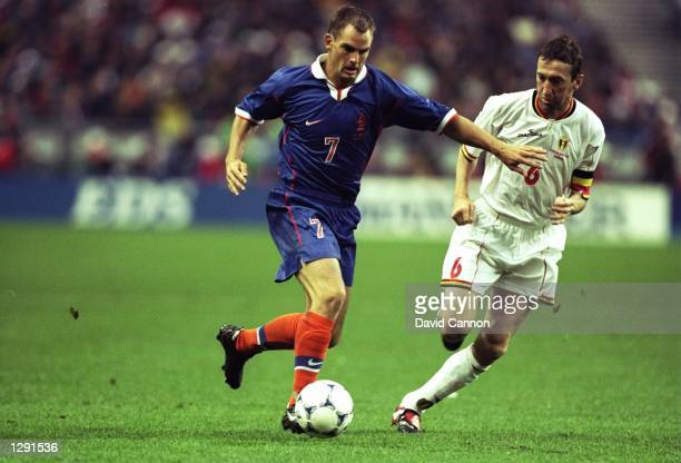 Ronald de Boer of Holland takes on Franky van der Elst of Belgium during the World Cup group E game at the Stade de France in St Denis France The...