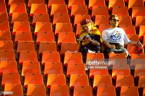 Scotland fans relax before the World Cup group A game against Morocco at the Stade Geoffroy Guichard in St Etienne France Scotland lost 30 Mandatory...