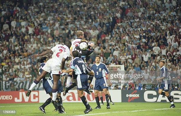 Sol Campbell of England rises to head the ball into the back of the Argentina net but the goal is disallowed for Alan Shearer's elbow on goalkeeper...