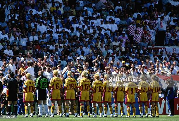 The Romanian team line up for their national anthem before their match against Croatia in the 1998 World Cup played in Bordeaux France Mandatory...
