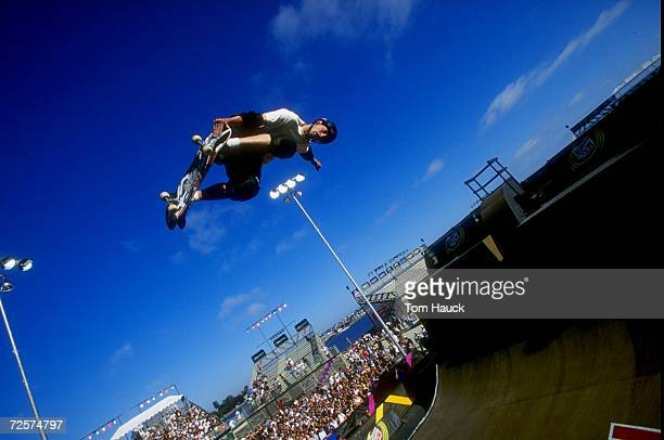 Tony Hawk grabs his skateboard vertical as he jumps from the ramp during the XGames in San Diego California Mandatory Credit Tom Hauck/Allsport