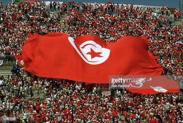 Tunisia fans unfurl a huge national flag during the World Cup group G game against England at the Stade Velodrome in Marseille France England won 20...