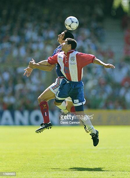 Youri Djorkaeff of France beats Jorge Campos of Paraguay in the air during the World Cup second round match at the Stade Felix Bollaert in Lens...