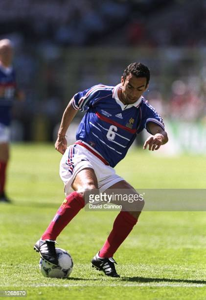 Youri Djorkaeff of France on the ball during the World Cup second round match against Paraguay at the Stade Felix Bollaert in Lens France France won...