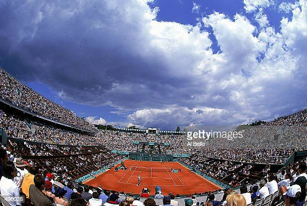 A general view shows the crowds at center court for the match between Gustavo Kuerten of Brazil and Andrei Medvedev of the Ukraine during the French...