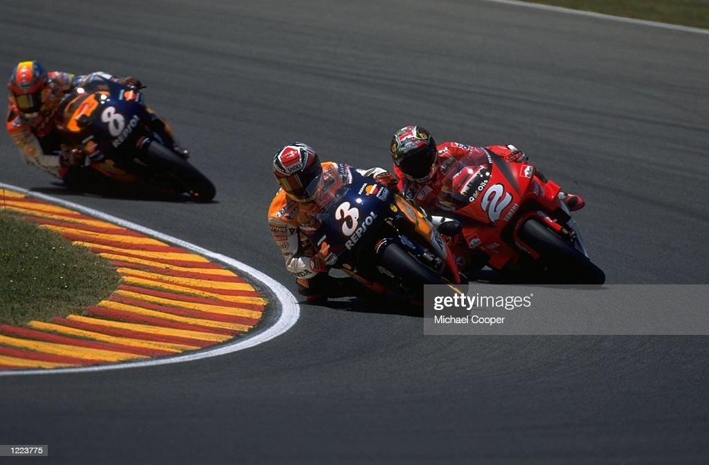 jun-1999-alex-criville-who-rides-a-honda-bike-leads-from-max-biaggi-picture-id1223775