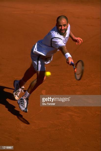 Andre Agassi of the United States in action during the 1999 French Open Final match against Andrei Medvedev of the Ukraine played at Roland Garros in...
