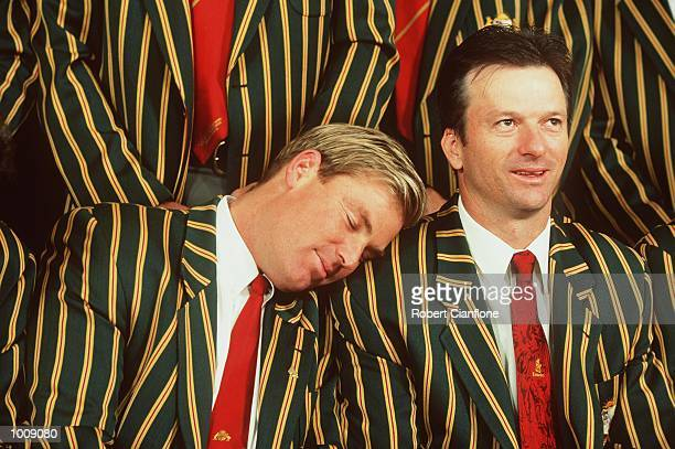 Australian cricketer Shane Warne takes a snooze on the shoulder of Steve Waugh, as the players prepare to pose for the official Australian Cricket...
