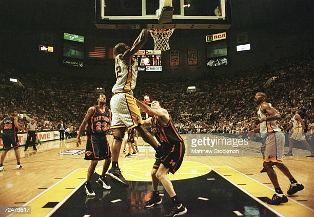 Dale Davis of the Indiana Pacers dunks the ball against Chris Dudley of the New York Knicks during game two of the NBA eastern conference finals at...