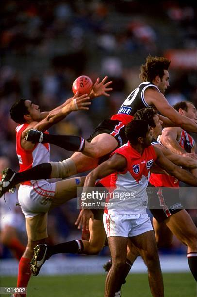 Darryl Wakelin of St Kilda jumps highest but Adam Goodes of Sydney catches the ball during the AFL Round 11match played at Waverley Park in Melbourne...