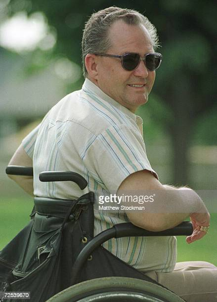 Former jockey Ron Turcotte watches as D Wayne Lukas addresses the media after morning workouts in preparation for the 131st Belmont Stakes at Belmont...