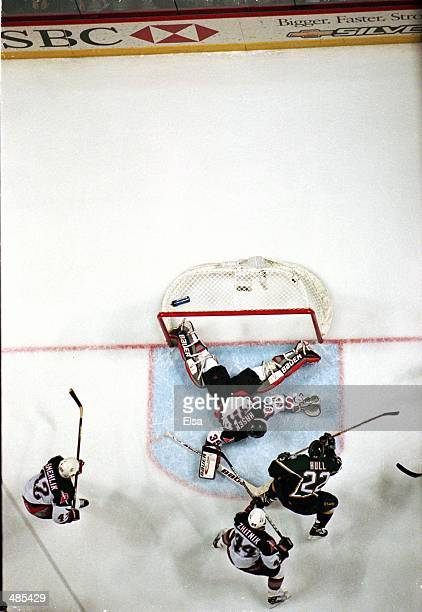Goalie Dominik Hasek of the Buffalo Sabres misses the final puck which was shot by Brett Hull of the Dallas Stars during the Stanley Cup Finals game...