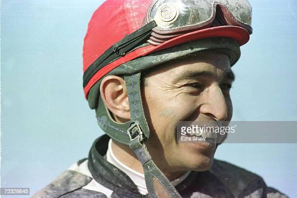 Jockey Jose Santos celebrates after riding Lemon Drop Kid to win the 131st Belmont Stakes at Belmont Park in Elmont New York Mandatory Credit Ezra...