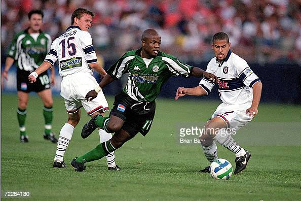 Jorge Dely Valdes of the Colorado Rapids runs with the ball as CJ Brown and Jesse Marsch of the Chicago Fire try to block him during the game at the...