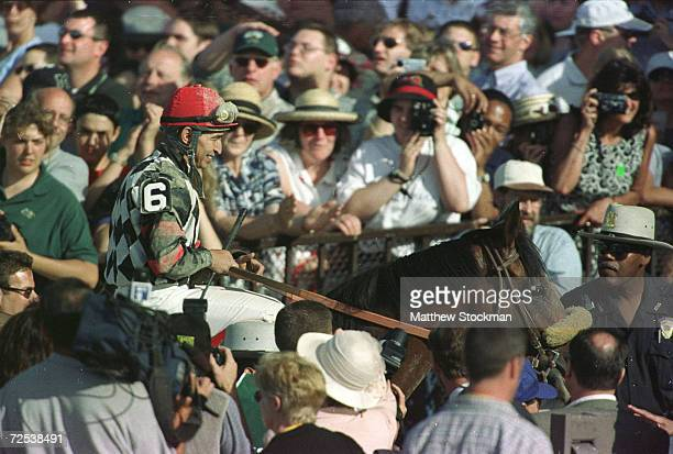Jose Santos rides Lemon Drpo Kid to the victory circle after winning the 131st Belmont Stakes at Belmont Park in Elmont New York Charismatic placed...