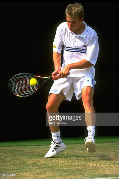 Mark Hilton of Great Britain in action during day nine of the Wimbledon Championships Junior Boys Tournament held at the All England Lawn Tennis Club...