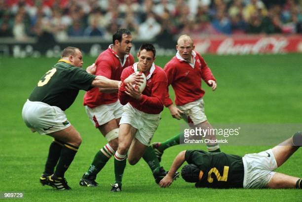 Mark Taylor of Wales runs with the ball during the Rugby Union International Friendly match against South Africa played at the Millennium Stadium in...