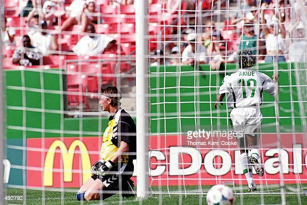 Mercy Akide of Team Nigeria scores a goal on Dorthe Larsen Team Denmark during the Womens World Cup Game at the Jack Kent Cooke Stadium in Landover...